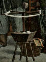 Close-up of 19th century Dutch swift, painted to look like a woman holding a baby